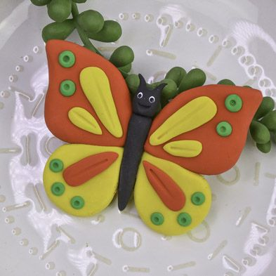 Red and Yellow Bendy Butterfly with green detail