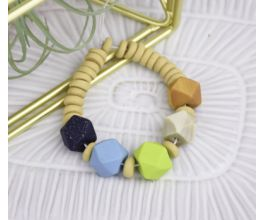 Faceted Beads Bracelet with navy blue, sky blue, light green, tan, and orange beads.