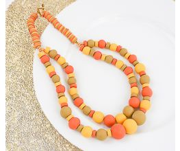 Ochre Double Strand Heishi Necklace with olive, yellow, and orange beads.