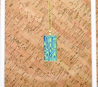 Shimmering Gold Pendant with blue, green, and yellow detail.
