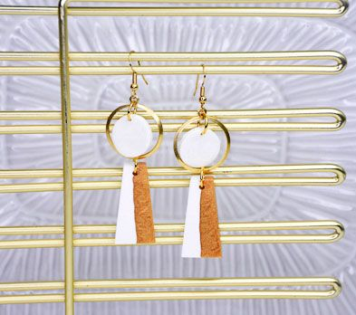 Gold earrings with white and tan detail