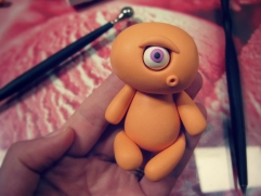 add the head to the body of the polymer clay monster