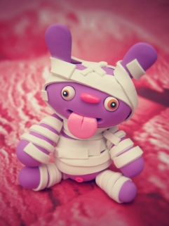 completed purple polymer clay monster mummy