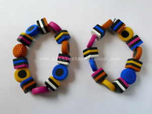 Liquorice bead bracelet can be made using polymer clay - just remember to poke holes in the unbaked beads so you can thread them together later.