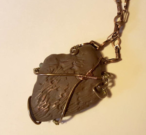 Pendant back, covered with clay