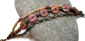 The pink/orange/gold tab bracelet was an experiment in Faux Raku.
