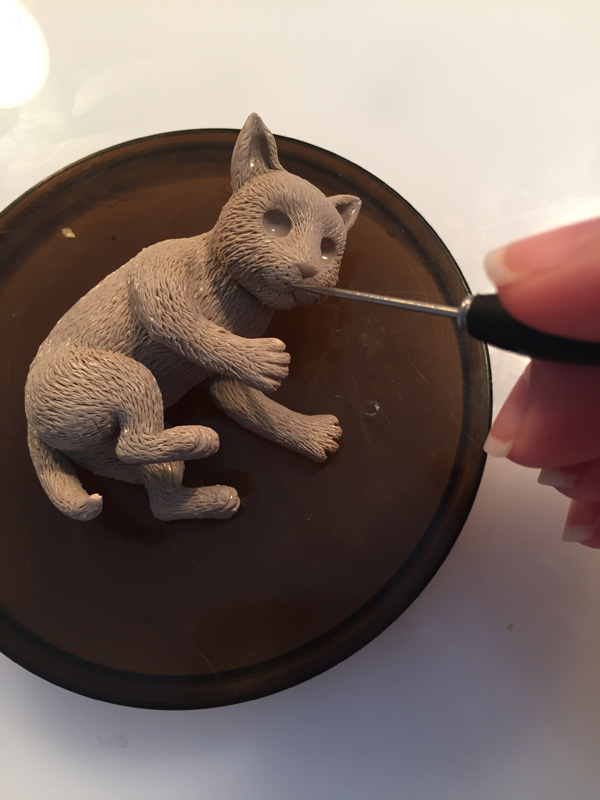 add whisker dots to clay cat