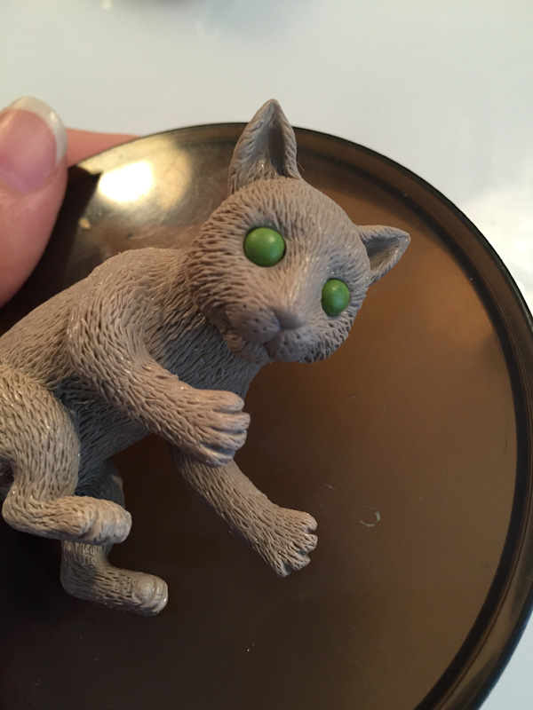add eyes to clay cat