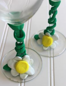 Add your flowers and leaves to the base of the stemware.