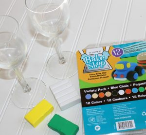 To make the wine glasses, you will need the following: GLASS stemware Sculpey Bake Shop Clay (Green, Yellow, White) Oven