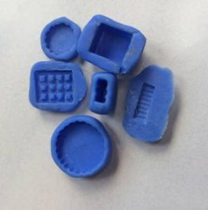 The more common 2-part blue silicone mold is also used a lot in making miniature food especially for smaller items since it is more flexible and that makes it easier to pop out from the mold compared to a stiffer mold like Oyumaru. Both molds do need to be greased with a special mold oil or baby powder so the clay does not stick to it. Another reason for me to use this type of mold is when I need to use it with liquid polymer clay because it can go into the oven. This mold isn't as versatile since you can't reuse it. As soon as it is mixed and hardens you cannot change it.