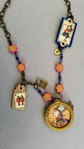My Alice necklace is a multimedia piece using paper, beads, metal and of course, clay!